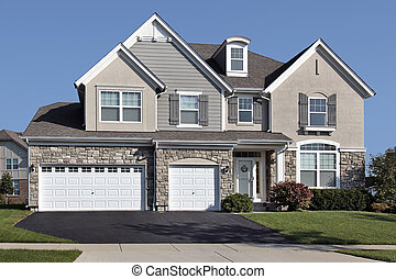 Home with three car stone garage