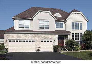 Home with three car stone garage
