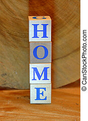 Home. Wooden cubes with blue letters