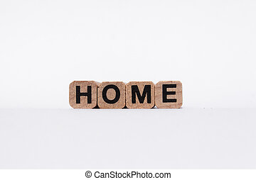 home - word / letters on wooden cub