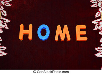Home word written with different colored letter blocks on a dark background