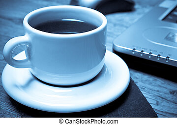 Home Working - Monochromatic blue tone image of espresso ...
