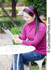 Home Working - Smiling young woman using tablet PC for ...