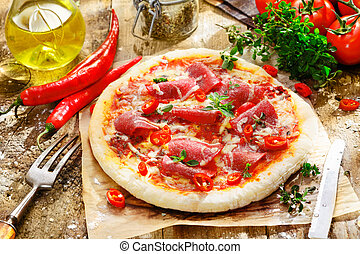 Homebaked pepperoni pizza with a delicious topping of salami...