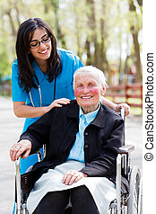 Homecare - Beautiful doctor, nurse in blue coat walking a...
