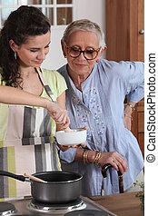 homecare, cozinhar, para, mulher sênior