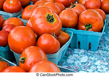 Homegrown - Fresh picked tomatoes in paper cartons.