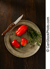 Homegrown Plum Tomatoes With Thyme - Overhead view of ripe, ...