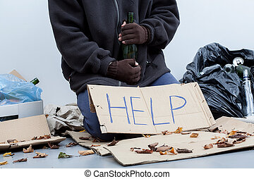 Homeless alcoholic holding a bottle