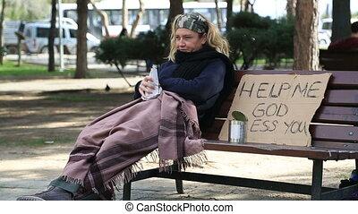 Homeless alcoholic woman drinking