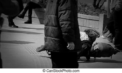 Homeless and disabled man begging for money