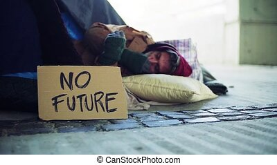Homeless beggar man lying outdoors in city, no future...