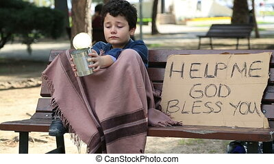 Homeless child begging in street