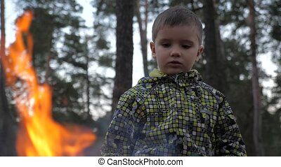 Homeless children. children of refugees. Setting fire to...