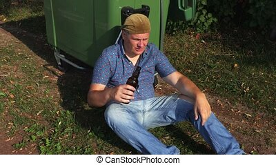 Homeless  drink alcohol near waste container