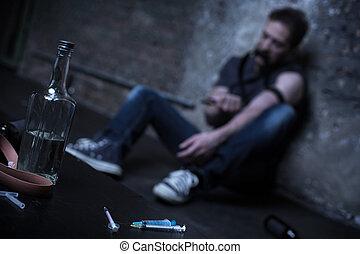 Homeless drug addict having heroin injection on the street