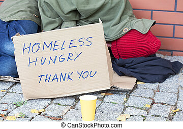 Homeless hungry poor man sleeping on a street