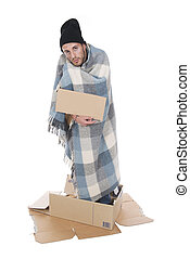 Homeless in his cardboard begging with a sign - Shooting in...