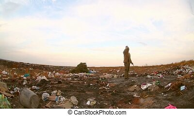 homeless looking for food in the garbage dump man food waste environmental protection
