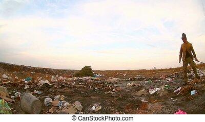 homeless looking man for food in the garbage dump food waste environmental protection