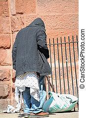 Homeless Man 2 - A homeless man outside a church on a sunny...