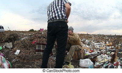 homeless man asking for money with a hat landfill pollution...