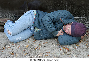 Homeless Man - Asleep By Dumpster - A homeless man sleeping...