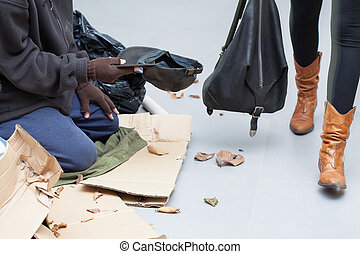 Homeless man begging for money on the street