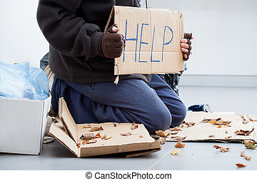 Homeless man begging - Homeless man on a street begging for...