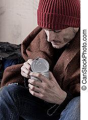 Homeless man eating preserve