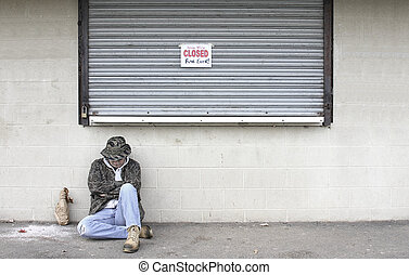 Homeless Man - Homeless man outside of a closed business...