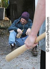 Homeless Man - In Danger - A homeless man nodding off drunk...