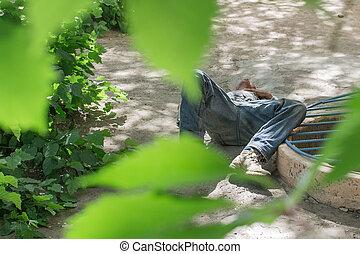 homeless man lies on the ground