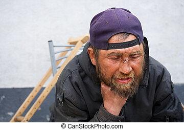 Homeless man on a city street.