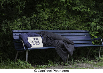 Homeless man on a park bench