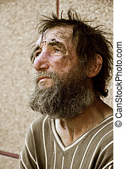 Homeless man - Poor homeless beggar in despair