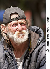 Portrait of homeless man outdoors