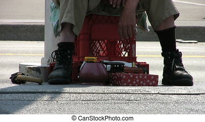 Homeless Man Selling Items Close Up