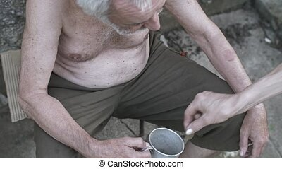 Homeless man with a cup asking for donation - Homeless old...