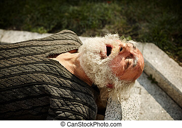 man with beard sleeping on the street