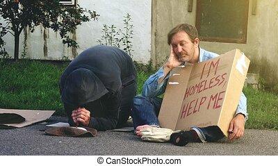 Homeless men on the street - Man on the street giving change...