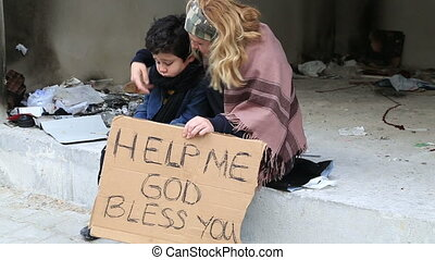 Homeless mother with her son beggin