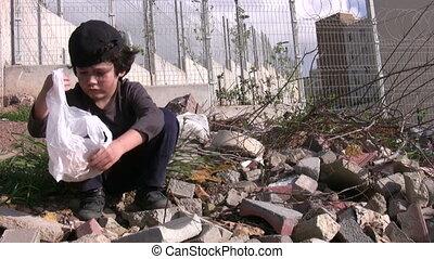 Homeless poor little boy
