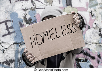 Homeless pray for home - Homeless man hold in his hands an ...