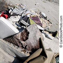 homeless shelter with broke mattresses and many garbage