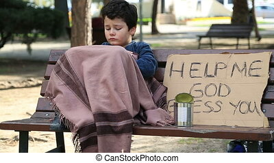 Homeless sick child begging