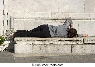 Homeless sleeping on the bench
