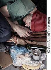 Homeless sleeping on the street - Homeless and alcoholic...