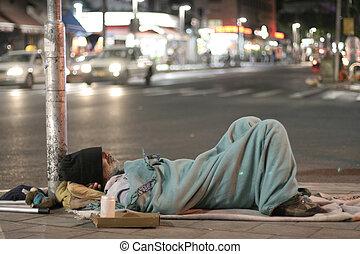 homeless - male homeless sleeping in a street