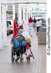 Homeless Vet - A homeless veteran in a wheelchair with a...